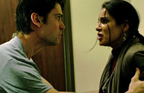 Gallery image from movie. A man and woman argue.