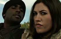 Gallery image from movie. A man and woman look at something.