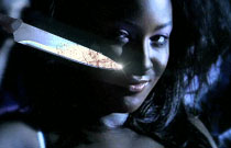 Gallery image from movie. Crazy girl with a knife.