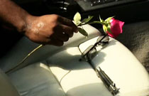 Gallery image from movie. A rose and a knife.