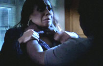 Gallery image from movie. Guy chokes a girl.