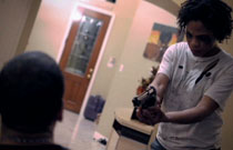 Gallery image from movie. A crazy woman holds a man at gunpoint.