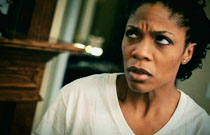Gallery image from movie. A woman looking upset.