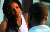 Gallery image from movie. A woman flirting with a man.
