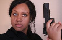 Gallery image from movie. Woman with gun.