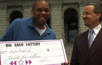 Isaac gets his big lottery check.