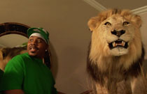 Gallery image from movie. A man and a lion.
