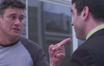 Gallery image from movie. Steven Bauer pointing at someone.