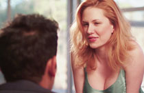 Gallery image from movie. A sexy redhead flirting.