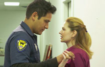 Gallery image from movie. A man consoling a woman.