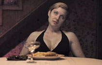Gallery image from movie. Zombie woman at dinner table.