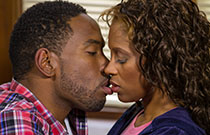 Gallery image from movie. Couple kissing.
