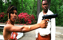 Gallery image from movie. Woman points a gun.