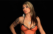 Gallery image from movie. Tattooed stripper.