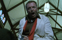 Gallery image from movie. A man yells.