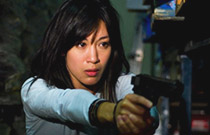 Gallery image from movie. Girl points a gun.