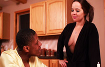 Gallery image from movie. A guy and his girlfriend talk in the kitchen.