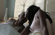 Gallery image from movie. A man and a woman wake up in the morning in bed.