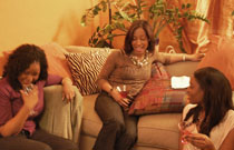 Gallery image from movie. A group of woman laughing.