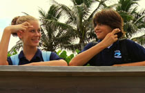 Gallery image from movie. A boy and girl make a promise to save the turtle eggs.