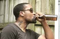 Gallery image from movie. A man drinking a beer.