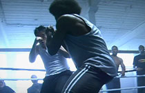 Gallery image from movie. Two men boxing.