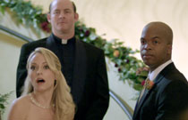 Gallery image from movie. The bride and groom are surprised.